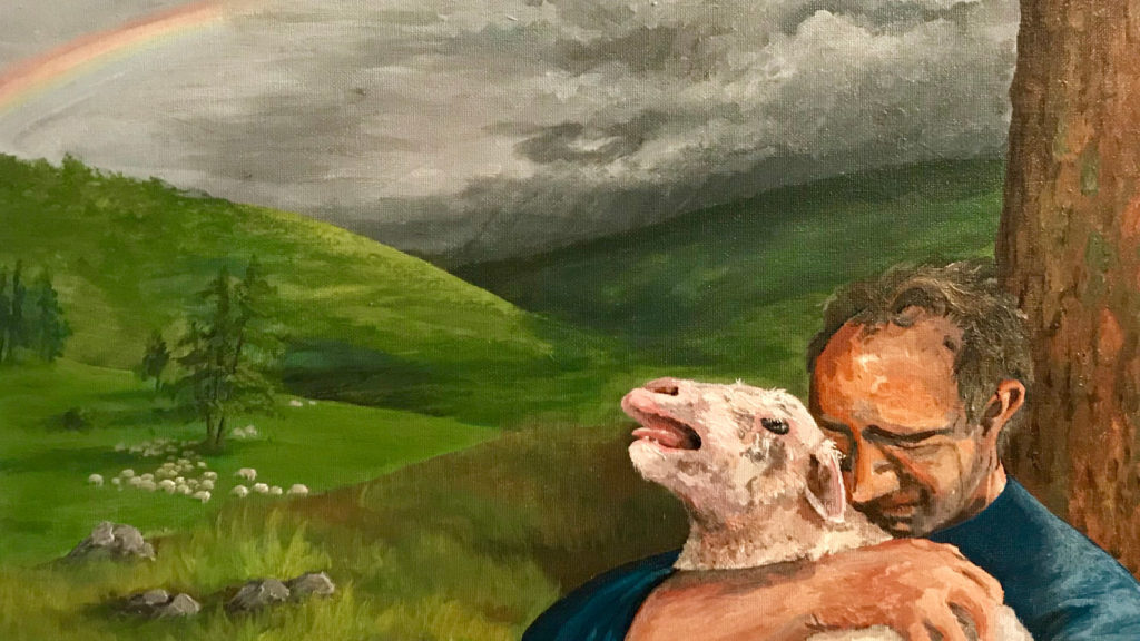 Shepherd holding his sheep